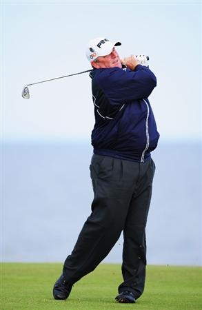 TURNBERRY, SCOTLAND - JULY 14:   Mark Calcavecchia of USA hits an iron shot during a practice round prior to the 138th Open Championship on the Ailsa Course, Turnberry Golf Club on July 14, 2009 in Turnberry, Scotland.  (Photo by Stuart Franklin/Getty Images)