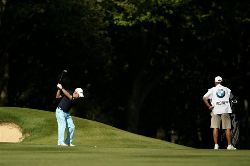 VIRGINIA WATER, ENGLAND - MAY 22:   Paul McGinley of Ireland hits an approach shot during the third round of the BMW PGA Championship on the West Course at Wentworth on May 22, 2010 in Virginia Water, England.  (Photo by Ian Walton/Getty Images)