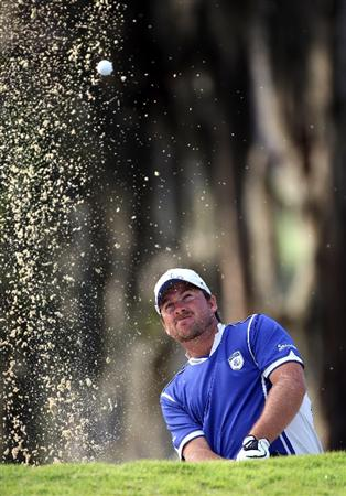 WINDERMERE, FL - MARCH 15:  Graeme McDowell of Northern Ireland hits a shot on the 18th hole during the second day of the Tavistock Cup at Isleworth Golf & Country Club on March 15, 2011 in Windermere, Florida.  (Photo by Sam Greenwood/Getty Images)