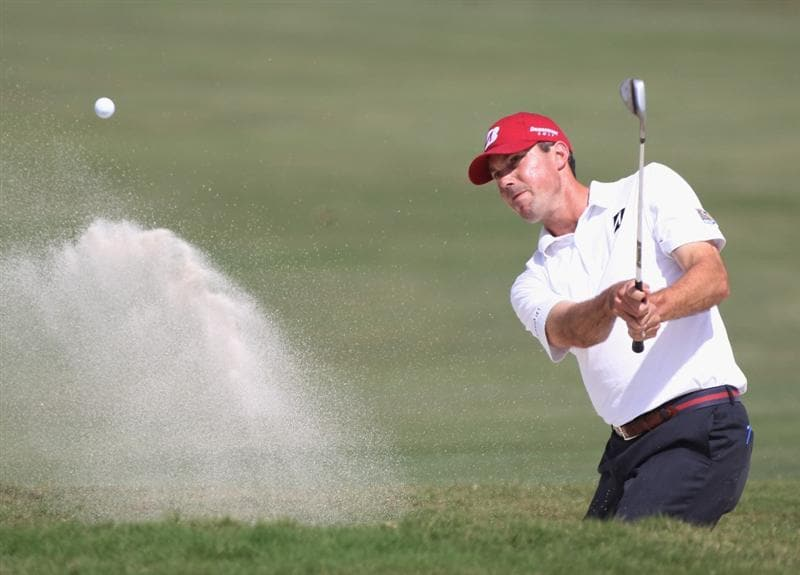 DORAL, FL - MARCH 12:  Matt Kuchar hits a bunker  shot on the fourth hole during the third round of the 2011 WGC- Cadillac Championship at the TPC Blue Monster at the Doral Golf Resort and Spa on March 12, 2011 in Doral, Florida.  (Photo by Sam Greenwood/Getty Images)