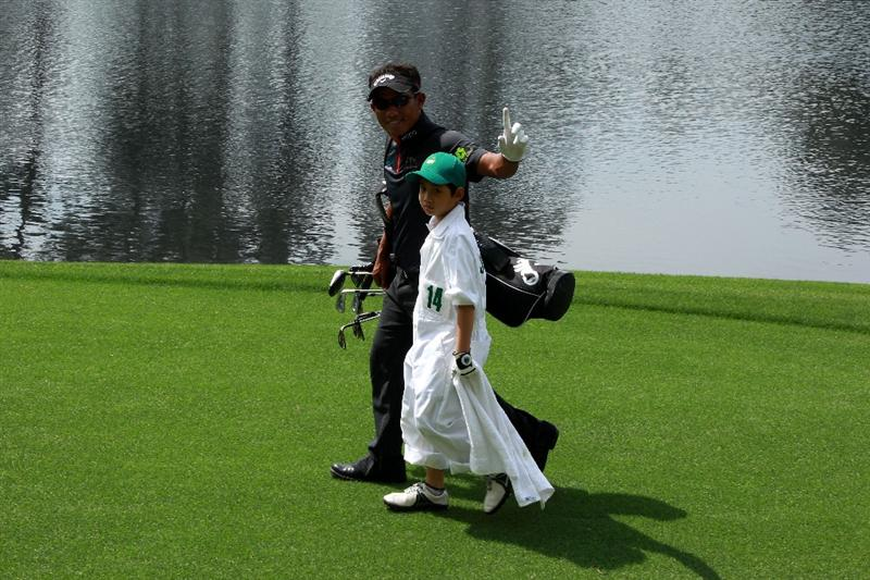 AUGUSTA, GA - APRIL 07:  Thongchai Jaidee of Thailand walks with his caddie during the Par 3 Contest prior to the 2010 Masters Tournament at Augusta National Golf Club on April 7, 2010 in Augusta, Georgia.  (Photo by David Cannon/Getty Images)
