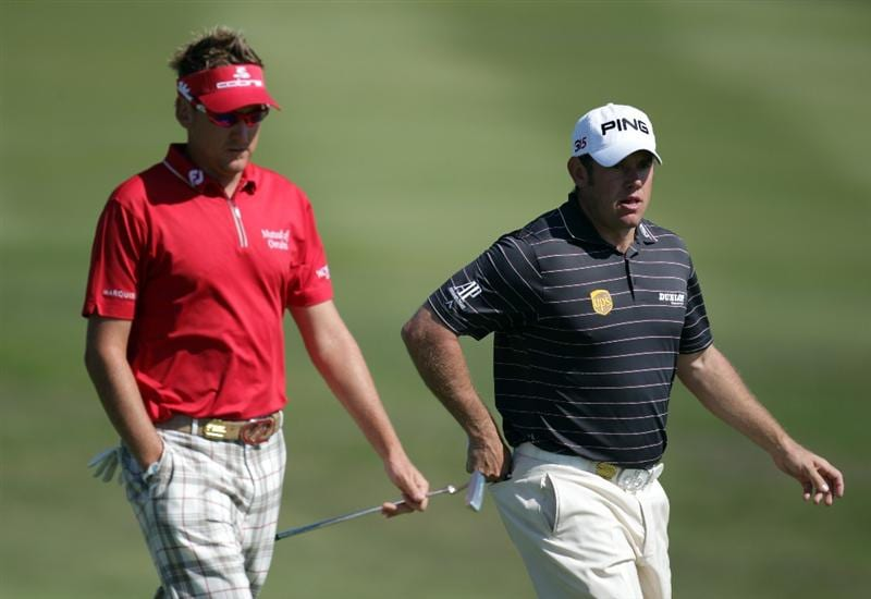 CASARES, SPAIN - MAY 21:  Ian Poulter of England and Lee Westwood of England during the last 16 match of the Volvo World Match Play Championships at Finca Cortesin on May 20, 2011 in Casares, Spain.  (Photo by Ross Kinnaird/Getty Images)
