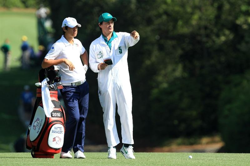 AUGUSTA, GA - APRIL 07:  Matteo Manassero of Italy, who is set to become the youngest ever competitor at the Masters, chats with his caddie Alberto Binaghi during a practice round prior to the 2010 Masters Tournament at Augusta National Golf Club on April 7, 2010 in Augusta, Georgia.  (Photo by David Cannon/Getty Images)