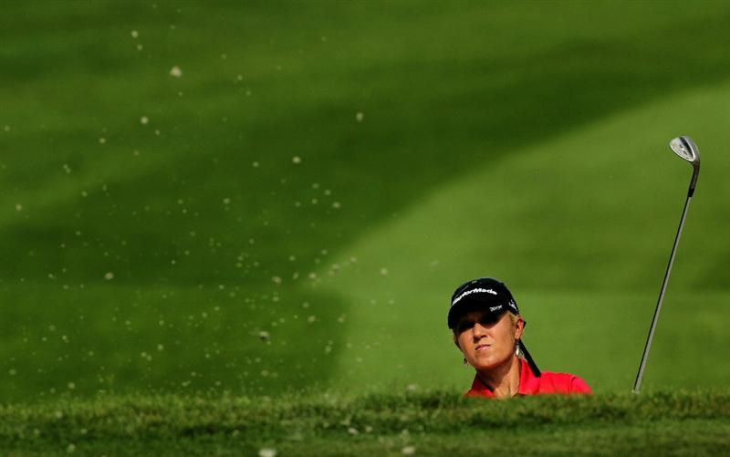 KUALA LUMPUR, MALAYSIA - OCTOBER 22:  Natalie Gulbis of USA hits her 3rd shot out of the bunker on the 1st hole during Round One of the Sime Darby LPGA on October 22, 2010 at the Kuala Lumpur Golf and Country Club in Kuala Lumpur, Malaysia. (Photo by Stanley Chou/Getty Images)
