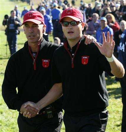 NEWPORT, WALES - OCTOBER 04:  USA Team Captain Corey Pavin (L) greets Zach Johnson on the first tee in the singles matches during the 2010 Ryder Cup at the Celtic Manor Resort on October 4, 2010 in Newport, Wales.  (Photo by David Cannon/Getty Images)
