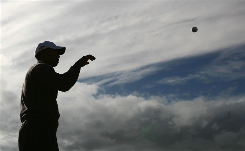 TURNBERRY, SCOTLAND - JULY 14:  Tiger Woods of USA is seen reaching for his golf ball during a practice round prior to the 138th Open Championship on the Ailsa Course, Turnberry Golf Club on July 14, 2009 in Turnberry, Scotland.  (Photo by Warren Little/Getty Images)