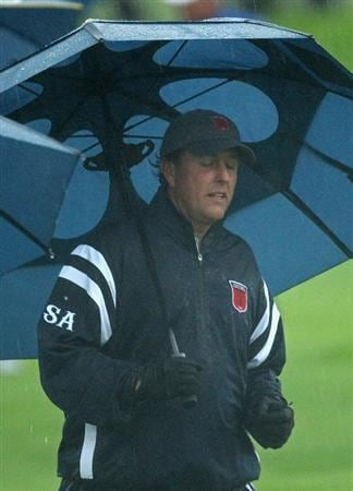 NEWPORT, WALES - OCTOBER 01:  Phil Mickelson of the USA looks on as the rain falls during the Morning Fourball Matches during the 2010 Ryder Cup at the Celtic Manor Resort on October 1, 2010 in Newport, Wales.  (Photo by Ross Kinnaird/Getty Images)