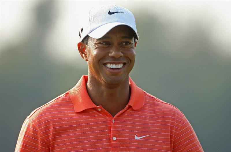 SHANGHAI, CHINA - NOVEMBER 05:  Tiger Woods of the USA smiles on the ninth hole during the first round of the WGC-HSBC Champions at Sheshan International Golf Club on November 5, 2009 in Shanghai, China.  (Photo by Andrew Redington/Getty Images)