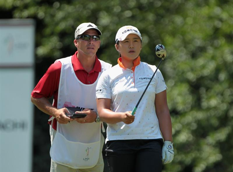 MOBILE, AL - APRIL 30:  Amy Yang of South Korea lines up a shot on the seventh hole with her caddie Greg Johnston during the third round of the Avnet LPGA Classic at the Crossings Course at the Robert Trent Jones Trail at Magnolia Grove on April 30, 2011 in Mobile, Alabama.  (Photo by Scott Halleran/Getty Images)