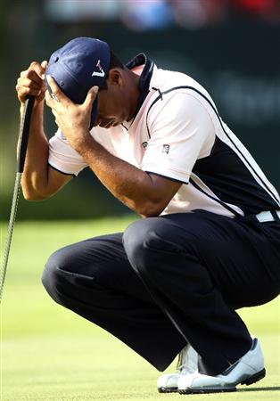 WINDERMERE, FL - MARCH 15:  Tiger Woods waits to play a shot on the 18th hole during the second day of the Tavistock Cup at Isleworth Golf & Country Club on March 15, 2011 in Windermere, Florida.  (Photo by Sam Greenwood/Getty Images)