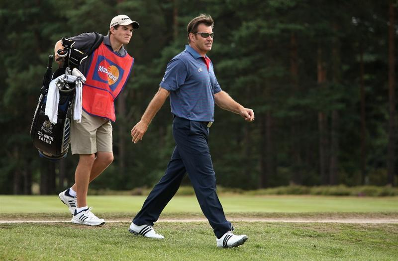 SUNNINGDALE, ENGLAND - JULY 25:  Sir Nick Faldo of England walks with his son and caddie Matthew during the third round of The Senior Open Championship presented by MasterCard held on the Old Course at Sunningdale Golf Club on July 25, 2009 in Sunningdale, England.  (Photo by Warren Little/Getty Images)