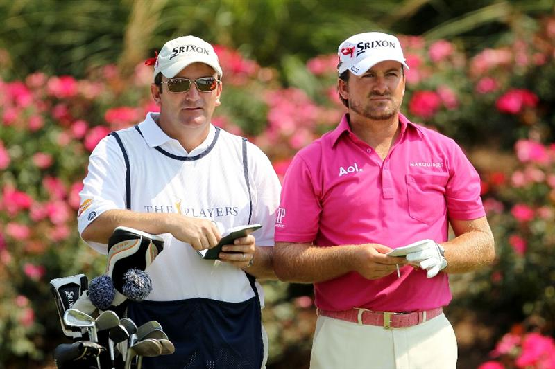 PONTE VEDRA BEACH, FL - MAY 12:  Graeme McDowell of Northern Ireland (R) and caddie Ken Comboy (L) look on from the tee on the 18th hole during the first round of THE PLAYERS Championship held at THE PLAYERS Stadium course at TPC Sawgrass on May 12, 2011 in Ponte Vedra Beach, Florida.  (Photo by Mike Ehrmann/Getty Images)