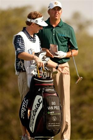 SAN ANTONIO, TX - APRIL 16: Bo Van Pelt (R) stands with his golf bag during the third round of the Valero Texas Open at the AT&T Oaks Course at TPC San Antonio on April 16, 2011 in San Antonio, Texas. (Photo by Darren Carroll/Getty Images)