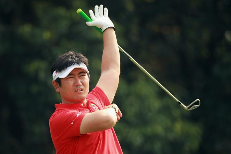 SHANGHAI, CHINA - NOVEMBER 05:  Y.E. Yang of South Korea watches his tee shot on the fourth hole during the second round of the WGC-HSBC Champions at Sheshan International Golf Club on November 5, 2010 in Shanghai, China.  (Photo by Andrew Redington/Getty Images)
