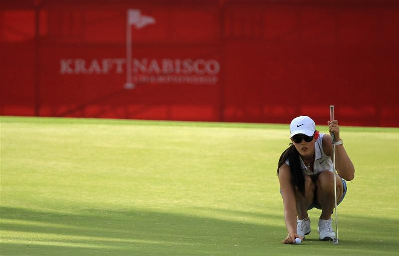 RANCHO MIRAGE, CA - APRIL 02:  Michelle Wie of the  USA putting at the par 5, 18th hole during the third round of the 2011 Kraft Nabisco Championship on the Dinah Shore Championship Course at the Mission Hills Country Club on April 2, 2011 in Rancho Mirage, California.  (Photo by David Cannon/Getty Images)