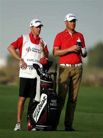 DOHA, QATAR - JANUARY 31:  Robert Karlsson of Sweden waits with his caddie Gareth Lord on the 18th hole during the final round of the Commercialbank Qatar Masters at Doha Golf Club on January 31, 2010 in Doha,Qatar.  (Photo by Andrew Redington/Getty Images)