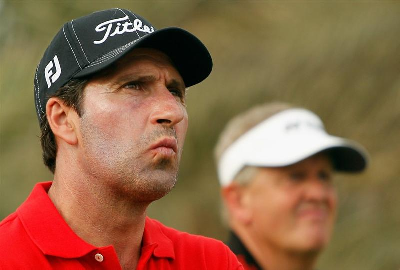 ABU DHABI, UNITED ARAB EMIRATES - JANUARY 20:  Jose Maria Olazabal of Spain (L) waits alongside Colin Montgomerie of Scotland on the 14th hole during the first round of the 2011 Abu Dhabi HSBC Golf Championship at the Abu Dhabi Golf Club on January 20, 2011 in Abu Dhabi, United Arab Emirates.  (Photo by Scott Halleran/Getty Images)