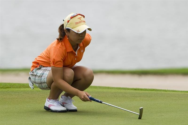 CHON BURI, THAILAND - FEBRUARY 21:  Mika Miyazato of Japan lines up a putt on the 8th hole during the final round of the Honda PTT LPGA Thailand at Siam Country Club on February 21, 2010 in Chon Buri, Thailand.  (Photo by Victor Fraile/Getty Images)
