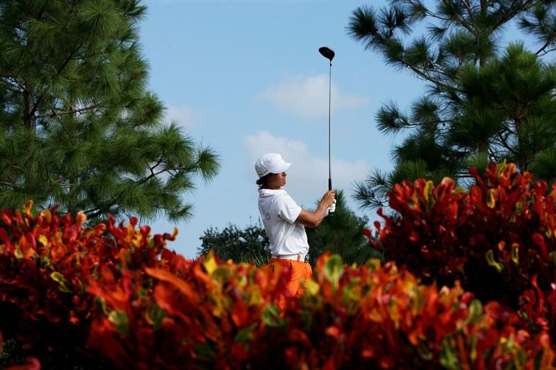 WEST PALM BEACH, FL - DECEMBER 07:  Rickie Fowler hits a tee shot on the 18th hole during the final round of the 2009 PGA TOUR Qualifying Tournament at Bear Lakes Country Club on December 7, 2009 in West Palm Beach, Florida.  (Photo by Doug Benc/Getty Images)