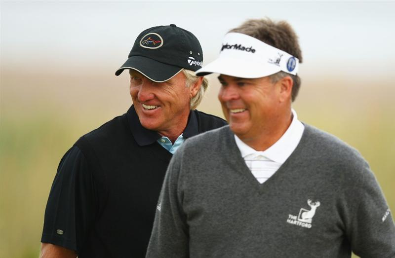 TURNBERRY, SCOTLAND - JULY 16:  Greg Norman (L) of Australia smiles as Kenny Perry of USA looks on during round one of the 138th Open Championship on the Ailsa Course, Turnberry Golf Club on July 16, 2009 in Turnberry, Scotland.  (Photo by Richard Heathcote/Getty Images)