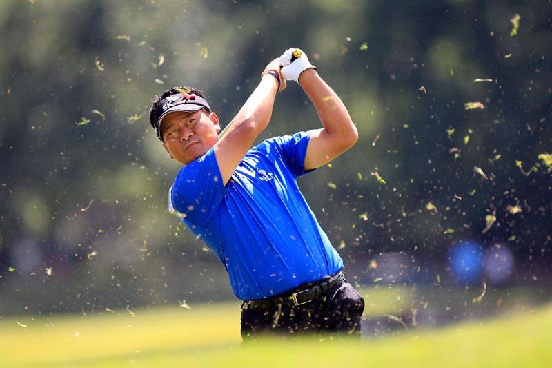 PONTE VEDRA BEACH, FL - MAY 15:  K.J. Choi of South Korea hits an approach shot on the seventh hole during the final round of THE PLAYERS Championship held at THE PLAYERS Stadium course at TPC Sawgrass on May 15, 2011 in Ponte Vedra Beach, Florida.  (Photo by Sam Greenwood/Getty Images)