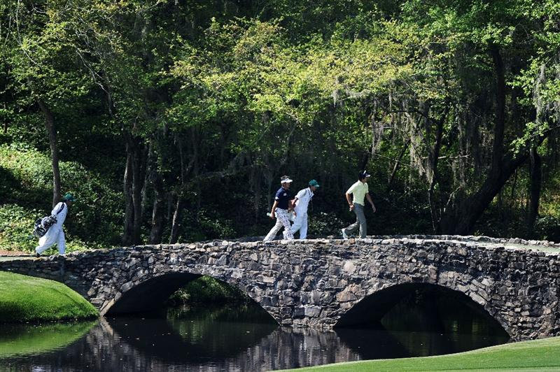 AUGUSTA, GA - APRIL 04:  Hiroyuki Fujita (L) and Ryo Ishikawa of Japan cross the Nelson Bridge with their caddies during a practice round prior to the 2011 Masters Tournament at Augusta National Golf Club on April 4, 2011 in Augusta, Georgia.  (Photo by Harry How/Getty Images)