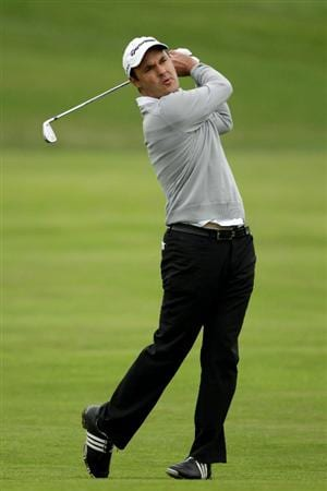 PEBBLE BEACH, CA - JUNE 15:  Simon Khan of England hits a shot during a practice round prior to the start of the 110th U.S. Open at Pebble Beach Golf Links on June 15, 2010 in Pebble Beach, California.  (Photo by Andrew Redington/Getty Images)