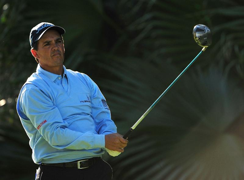 LAKE BUENA VISTA, FL - NOVEMBER 13:  Tom Pernice Jr. plays a shot on the 17th hole during the second round of the Children's Miracle Network Classic at the Disney Palm and Magnolia courses on November 13, 2009 in Lake Buena Vista, Florida.  (Photo by Sam Greenwood/Getty Images)