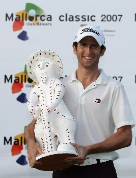 MALLORCA, SPAIN - OCTOBER 28:  Gregory Bourdy of France celebrates with the Mallorca Classic trophy after winning the Mallorca Classic 2007 at Pula Golf Club on October 28, 2007 in  Mallorca, Spain.  (Photo by Ian Walton/Getty Images)