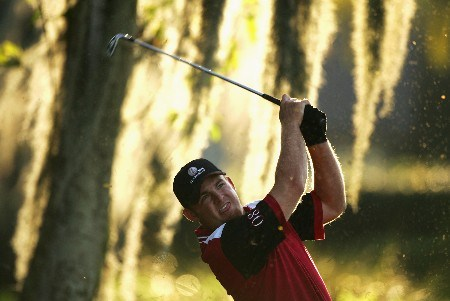 ORLANDO, FL - MARCH 24:  J.B. Holmes of the USA and Member of the Isleworth team plays his second shot into the 17th green during the first day of the Travistock Cup at Isleworth Golf and Country Club on March 24, 2008 in Orlando, Florida.  (Photo by Warren Little/Getty Images)