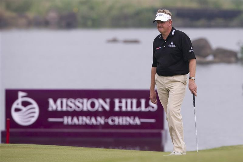 HAIKOU, CHINA - OCTOBER 31:  Colin Montgomerie of Scotland walks on the 18th green during day five of the Mission Hills Start Trophy at Mission Hills Resort on October 31, 2010 in Haikou, China.  The Mission Hills Star Trophy is Asia's leading leisure liflestyle event and features Hollywood celebrities and international golf stars.  (Photo by Victor Fraile/Getty Images for Mission Hills)