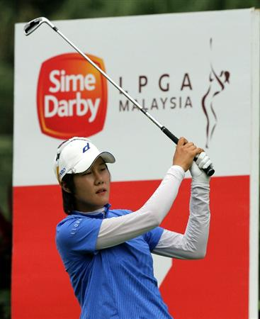KUALA LUMPUR, MALAYSIA - OCTOBER 24 : Song-Hee Kim of Korea Republic tees off on the 14th hole during the Final Round of the Sime Darby LPGA on October 24, 2010 at the Kuala Lumpur Golf and Country Club in Kuala Lumpur, Malaysia. (Photo by Stanley Chou/Getty Images)