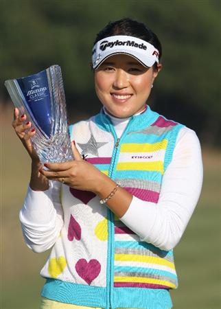 SHIMA, JAPAN - NOVEMBER 08:  Bo Bae Song of South Korea holds the trophy winning the Mizuno Classic at Mizuno Classicat Kintetsu Kashikojima Country Club on November 8, 2009 in Shima, Japan.  (Photo by Koichi Kamoshida/Getty Images)