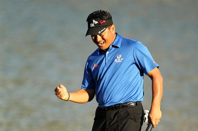 PONTE VEDRA BEACH, FL - MAY 15:  K.J. Choi of South Korea celebrates making birdie on the 17th hole during the final round of THE PLAYERS Championship held at THE PLAYERS Stadium course at TPC Sawgrass on May 15, 2011 in Ponte Vedra Beach, Florida.  (Photo by Mike Ehrmann/Getty Images)