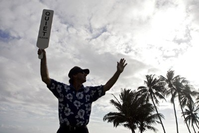 A volunteer holds up a 'QUIET' sign on the 17th tee during the first round of the Sony Open held at the Waialae Country Club, Thursday, Jan. 11 2006 in Honolulu. PGA TOUR - 2007 Sony Open - First RoundPhoto by Marco Garcia/WireImage.com