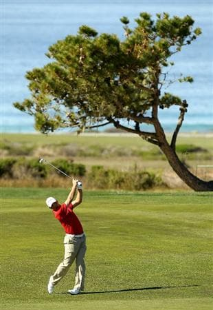 PEBBLE BEACH, CA - FEBRUARY 11:  Gary Woodland hits his second shot on the 16th hole during the second round of the AT&T Pebble Beach National Pro-Am at Monterey Peninsula Country Club on February 11, 2011 in Pebble Beach, California.  (Photo by Ezra Shaw/Getty Images)