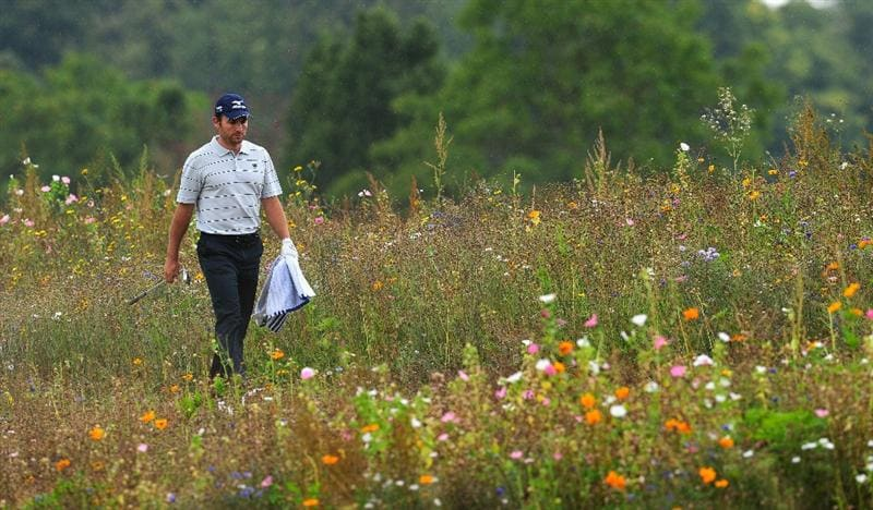 PARIS - SEPTEMBER 23:  Ignacio Garrido of Spain walks through the flowers during the first round of the Vivendi cup at Golf de Joyenval on September 22, 2010 in Chambourcy, near Paris, France.  (Photo by Stuart Franklin/Getty Images)