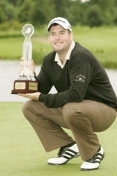Kenneth Ferrie holds the championship trophy after the final round of the 2005 Smurfit European Open on the Palmer Course at the K Club, July 3, 2005.Photo by Pete Fontaine/WireImage.com
