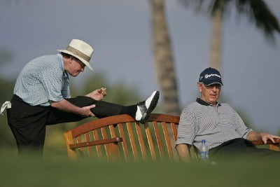 Tom Kite stretches while he and Hale Irwin wait on the 14th tee during the first round of the 2006 Mastercard Championship  at Hualalai resort,  Kona, Hawaii. January 20,2006Photo by: Chris Condon/PGA TOUR