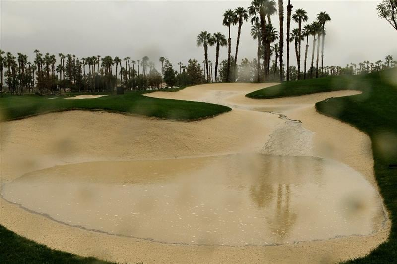 LA QUITNA, CA - JANUARY 21: A puddle fills a sand trap on the Palmer Private Course at PGA West before the delayed second round of the Bob Hope Classic on January 21, 2010 in La Quinta, California. (Photo by Stephen Dunn/Getty Images)