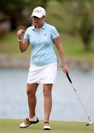 SINGAPORE - FEBRUARY 25:  Cristie Kerr of the USA holes her putt on the 18th green during the first round of the HSBC Women's Champions at the Tanah Merah Country Club on February 25, 2010 in Singapore.  (Photo by Ross Kinnaird/Getty Images)
