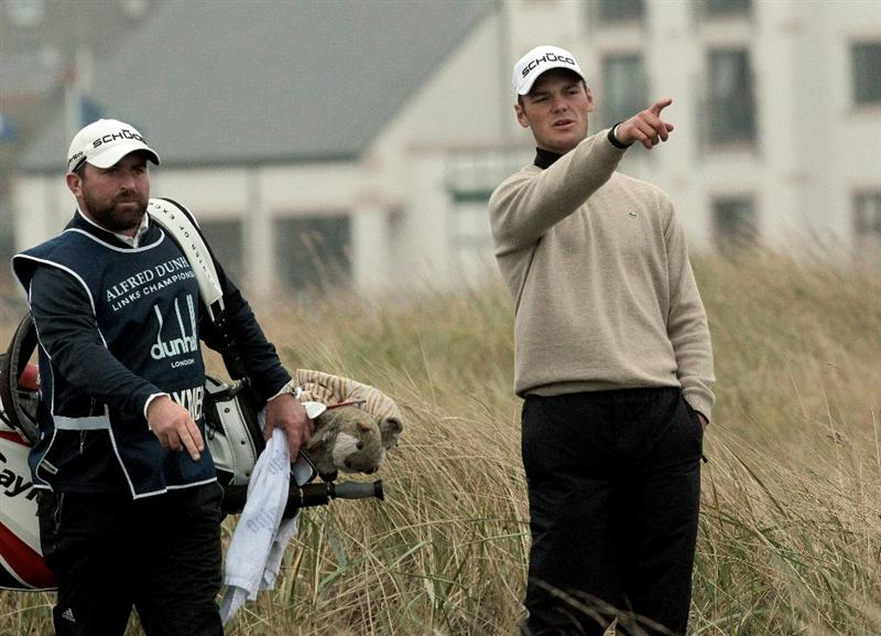 CARNOUSTIE, SCOTLAND - OCTOBER 09:  Martin Kaymer of Germany with his caddie on the second fairway during the third round of The Alfred Dunhill Links Championship at the Carnoustie Golf Links on October 9, 2010 in Carnoustie, Scotland.  (Photo by David Cannon/Getty Images)