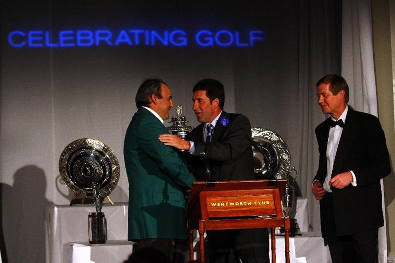 WENTWORTH, ENGLAND - MAY 19:  2009 Masters Champion Angel Cabrera (L) of Argentina, Jose Maria Olazabal of Spain (C) and George O'Grady (R), Chief Executive of The European Tour, on stage at The European Tour Dinner during the BMW PGA Championship at Wentworth on May 19, 2009 in Virginia Water, England.  (Photo by Andrew Redington/Getty Images)