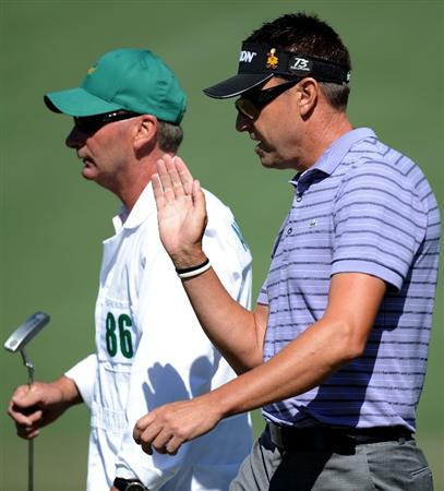 AUGUSTA, GA - APRIL 07:  Robert Allenby of Australia walks with his caddie Steven Potts on the second green during the first round of the 2011 Masters Tournament at Augusta National Golf Club on April 7, 2011 in Augusta, Georgia.  (Photo by Harry How/Getty Images)
