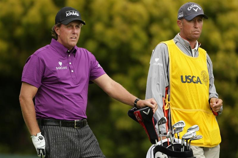 PEBBLE BEACH, CA - JUNE 18:  (L-R) Phil Mickelson and caddie Jim Mackay look on from the 12th tee during the second round of the 110th U.S. Open at Pebble Beach Golf Links on June 18, 2010 in Pebble Beach, California.  (Photo by Andrew Redington/Getty Images)