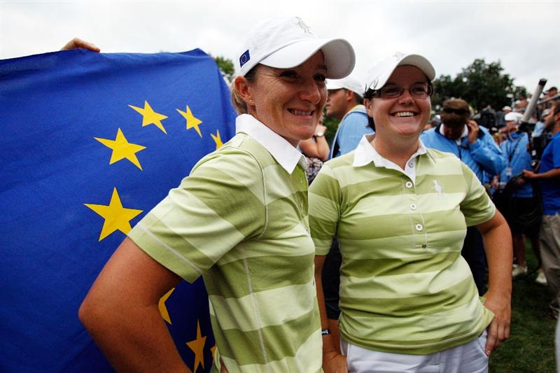 SUGAR GROVE, IL - AUGUST 22:  Gwladys Nocera (L) and Becky Brewerton of the European Team stand on the 14th green after defeating Natalie Gulbis and Christina Kim of the U.S. Team during the Saturday afternoon Foursomes matches at the 2009 Solheim Cup at Rich Harvest Farms on August 22, 2009 in Sugar Grove, Illinois.  (Photo by Chris Graythen/Getty Images)