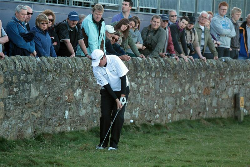 ST ANDREWS, SCOTLAND - OCTOBER 07:  Shane Lowry of Ireland in trouble for his third shot against the wall on the par 4, 17th hole during the first round of The Alfred Dunhill Links Championship at The Old Course on October 7, 2010 in St Andrews, Scotland.  (Photo by David Cannon/Getty Images)