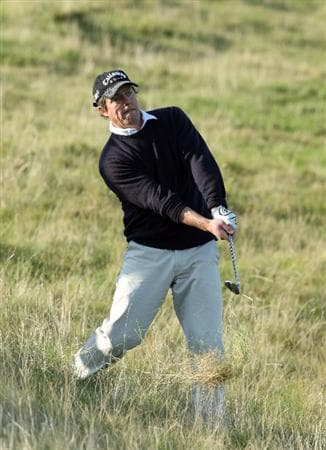 KINGSBARNS, UNITED KINGDOM - OCTOBER 02:  Film actor Hugh Grant plays out from the rough on the seventh hole during the first round of The Alfred Dunhill Links Championship at Kingsbarns Golf Links on October 2, 2008 in Kingbarns, Scotland.  (Photo by David Cannon/Getty Images)