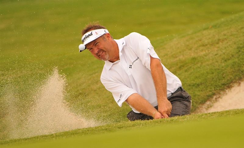 IRVING, TX - MAY 23:  Ken Duke blasts out of the greenside bunker on the 12th hole during the third round of the HP Byron Nelson Championship held at the TPC Four Seasons Resort Las Colinas on May 23, 2009 in Irving, Texas.  (Photo by Marc Feldman/Getty Images)