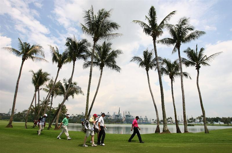 SINGAPORE - NOVEMBER 16:  Padraig Harrington (2nd R) and Jeev M. Singh (R) of India walk down the 5th fairway during the final round of the Barclays Singapore Open at Sentosa Golf Club on November 16, 2008 in Singapore.  (Photo by Ian Walton/Getty Images)